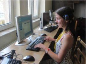 blind student navigating a keyboard